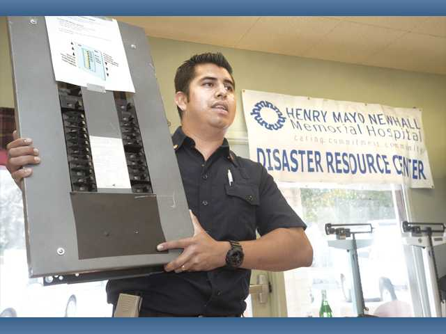 Antonio Magdaleno, a Henry Mayo Newhall Memorial Hospital disaster planner, uses an electrical panel to show how to check circuit breakers after an emergency at a seminar at the SCV Senior Center on Wednesday.