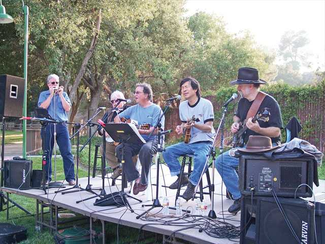 The All Digital String Band plays on the patio of Hart Hall.