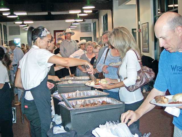 Guests enjoy a buffet dinner from Rattler's served in Hart Hall.
