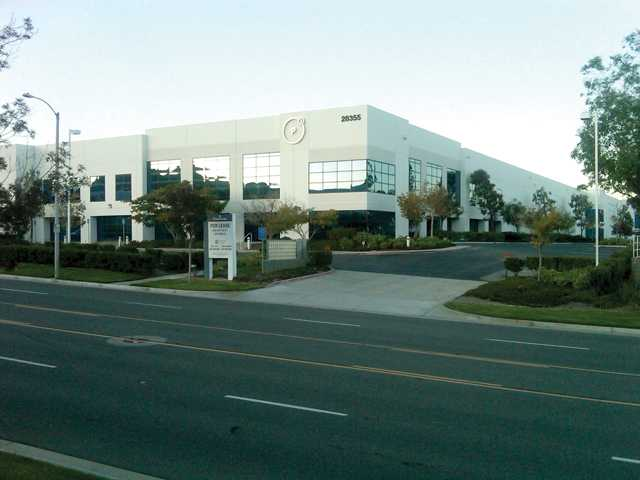 Deluxe Media Management has leased a 229,450-square-foot building at Vista Business Park, pictured above, in Valencia.