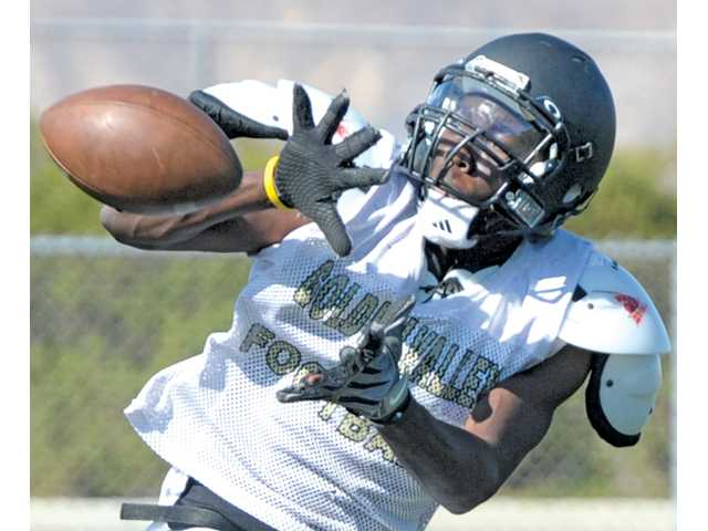 Golden Valley wide receiver Aaron Kinard catches a pass during training camp on Wednesday at Golden Valley High.