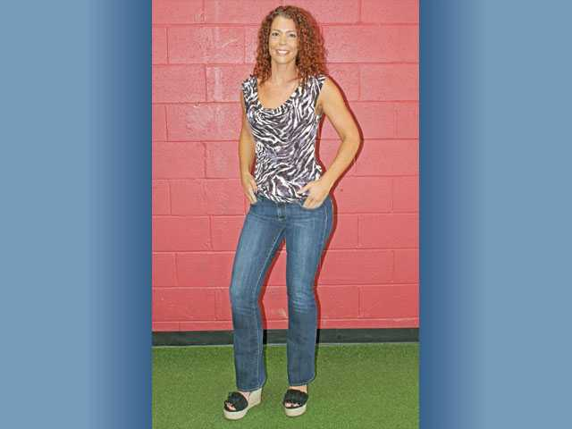 "A year later, Madia still fits into her ""rocking"" jeans size, which are three sizes smaller than she wore previously. Madia is wearing jeans from J. Serraino Clothing."