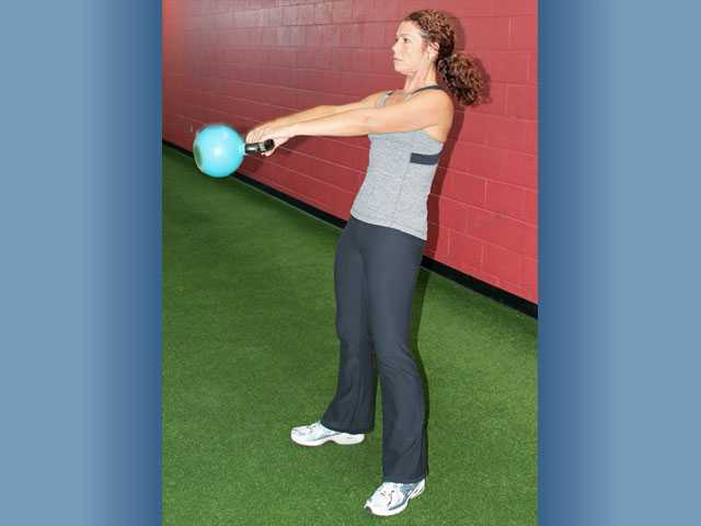 Madia performs a kettlebell swing.