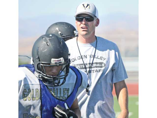 The 2011 Golden Valley football team is adjusting to the departure of former head coach Andy Campbell and the hiring of new head coach Robert Fisher, which became official just last week. The Grizzlies are responding with an intense training camp.