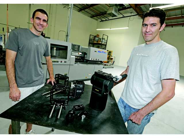 Josh von Badinski, left, and his brother Curt of View Factor Studios in Valencia are part of a family-operated business that manufactures camera support products for the cinema and television industries.