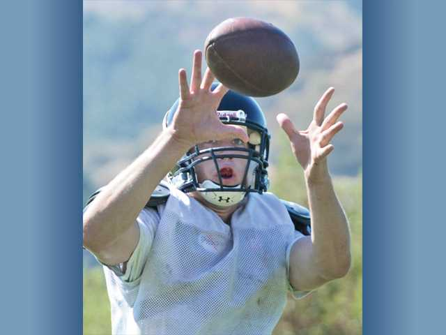SCCS tight end Ethan Vernon reaches out to catch a ball during a practice at The Master's College on Friday.