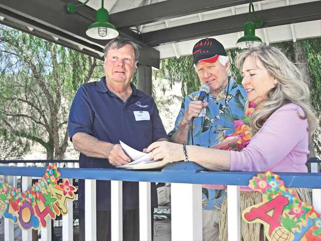 Santa Clarita City Councilman Bob Kellar, left, was crowned Big Kahuna for his work with at the Santa Clarita Valley Senior Center during its volunteer recognition event on Aug. 7. Kellar, Greg Nutter and Robin Clough distributed more than 150 recognition certificates during the Hawaiian-themed celebration.
