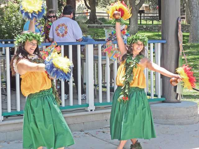 Dancers Luana Bosco-Shock, left, and Mahalia Leilani Brehm, right, who are also senior center volunteers, donated their performance to add to the festivities.