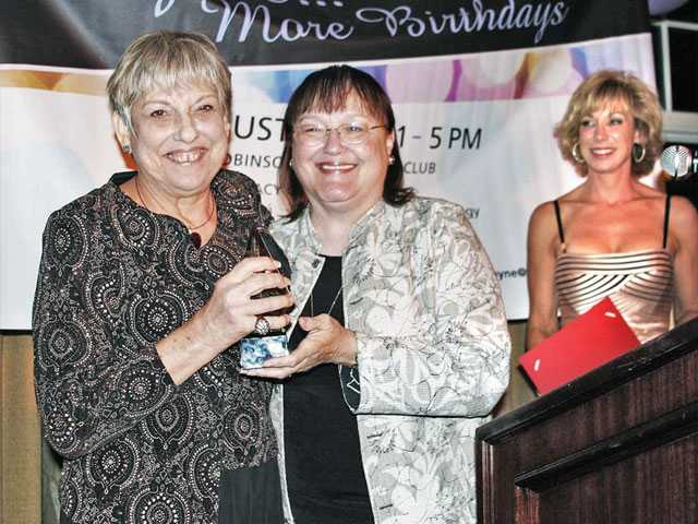 Judith Harris is presented the Award of Distinction by Nancy Coulter.