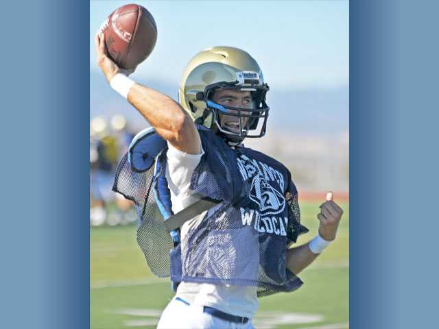 West Ranch quarterback Gerrit Mouw winds up to throw a pass during practice on Tuesday at West Ranch High School. Mouw is slated to be the team's starting quarterback this season, but has big shoes to fill following graduate Connor Eichten.