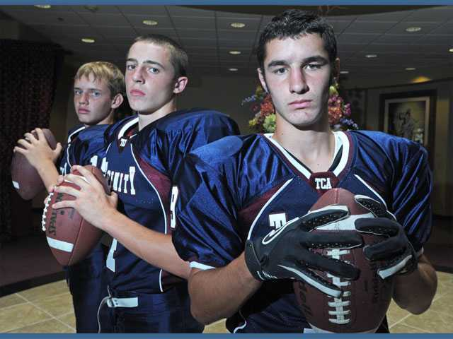 Trinity Classical Academy quarterbacks (left to right) Chris Buchanan, Spencer Klehn and Dakota Prochnow insist that the three of them seeing time this year won't hinder the team. The trio has a deep friendship that helps them on and off the field.