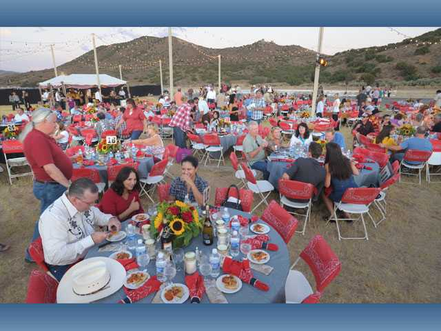 Guests enjoy dinner under the stars at the Agua Dulce Airport at the annual fundraiser.