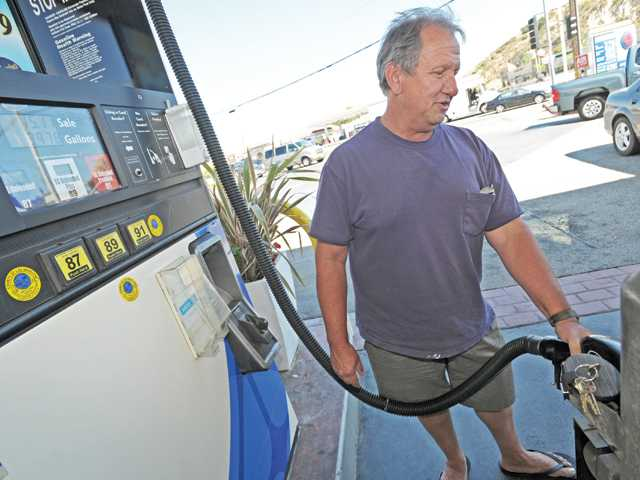 Tommy DeSantis, of Saugus, fills up his Jeep at the Arco station on Bouquet Canyon Road and Valencia Boulevard in Valencia on Thursday.
