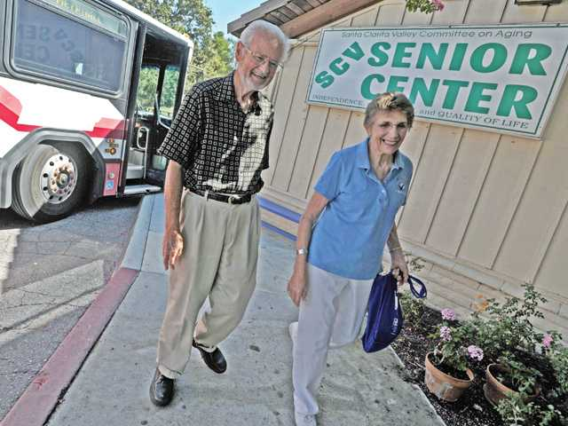 Frank Ford, left, and Rita Hendrixson arrive at the Santa Clarita Valley Senior Center in Newhall via a city of Santa Clarita Transit bus in August. Both regularly use the public transportation system to get to and from the senior center.