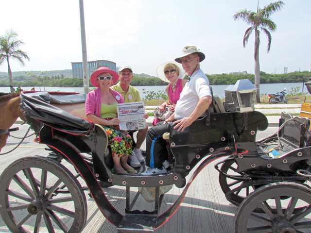 From left, Donna Pugh, Tim Pugh, Karen Welling and Brent Welling take a carriage ride through the old city in Cartanega, Columbia, as part of a 15-day Panama Canal cruise.