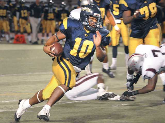 College of the Canyons running back Jamie Wilson (10) heads for the end zone during the third quarter against Antelope Valley College on Saturday at COC. It was one of three touchdowns Wilson scored in the game.