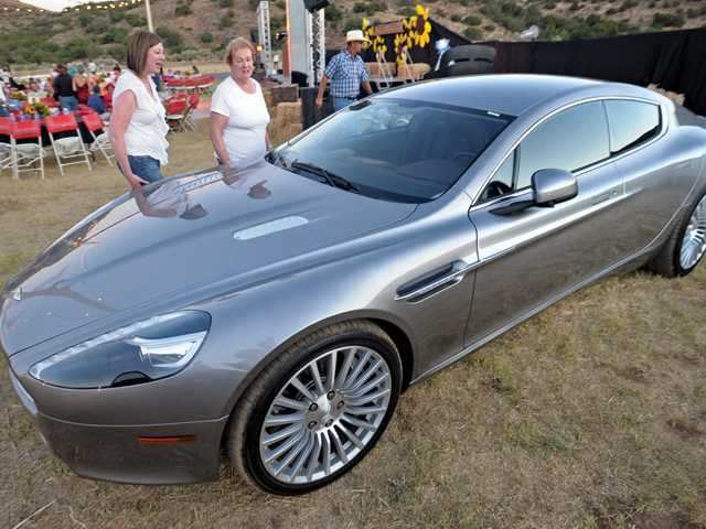 Karen Dominguez, left, and Betty Clarke, of Newhall, examine the Aston Martin Rapide offered in the live auction for a weekend rental.