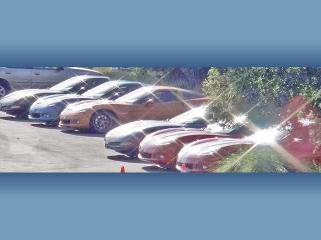 A lineup of Corvettes in the parking of Robinson Ranch gleam in the sunshine during the SCV Corvette Club's 30th anniversary event.