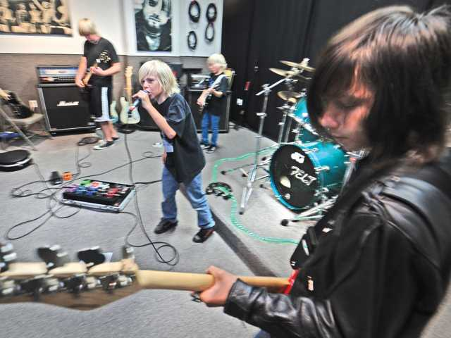 Members of Lockdown perform at Hubbadaddy's rehearsal studio, where the band formed during its After School Rock program.