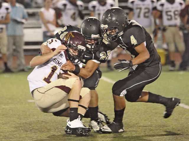 Prep football: It's one inch at a time