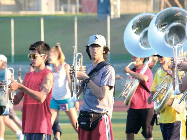 The award-winning William S. Hart regiment marching band and color guard spent the last few weeks of summer vacation practicing its 2011 fall marching show.