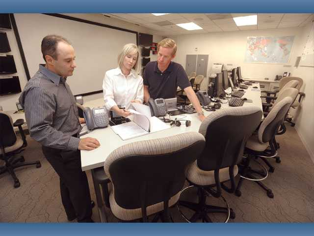 Princess Cruises executives, from left,  Eric Findon, vice president of customer service; Julie Benson, vice president of public relations; and John Sifling, vice president of fleet security, stand in the Princess Cruises Emergency Response Center in Valencia on Friday.