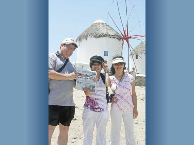 From left, Doug, Kelsey and Sarah Ridnor pose with The Signal on the Greek island of Mykonos while on a 10-day Eastern Mediterranean cruise.
