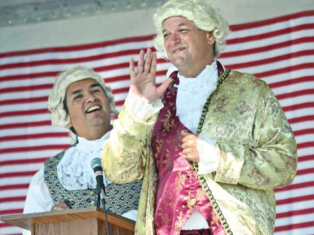 "Carlo Basail, dressed as ""Gouverneur Morris,"" left, and John Rogers, as ""John Hancock,"" give a rendition of the writing of the preamble to the Constitution at the Constitution Day Summit held at West Creek Community Park in Santa Clarita on Saturday."