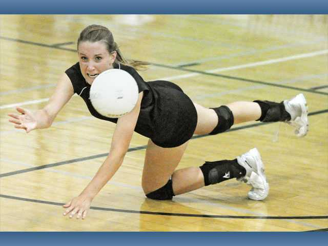 Canyon High's Morgan Fay goes for a dig against St. Bonaventure on Wednesday at Canyon High School. The Cowboys won the match in four games.