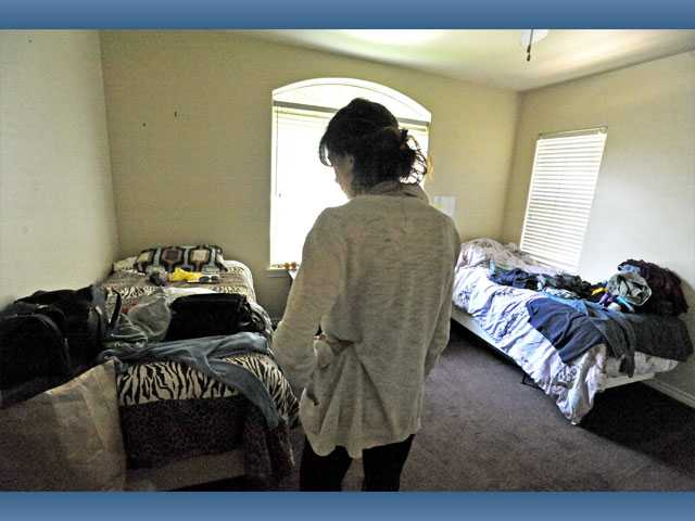 Lauren (no last name given), a recovering heroin addict, overlooks her shared bedroom at the Saugus recovery home.