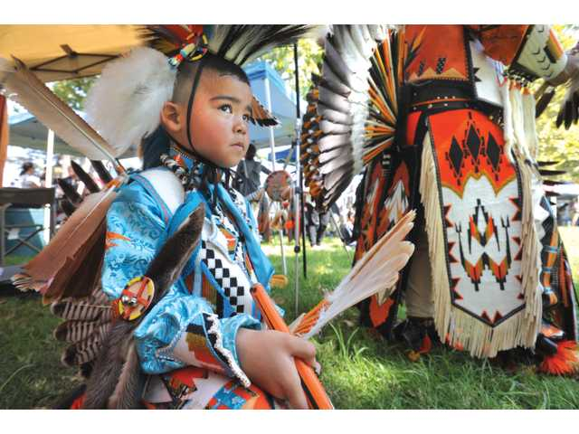 Sam Sierra, 6, wearing Northern traditional regalia, prepares to participate in the intertribal dance at the 18th annual Pow Wow and Native American Craft Show held at William S. Hart Park in Newhall on Saturday.