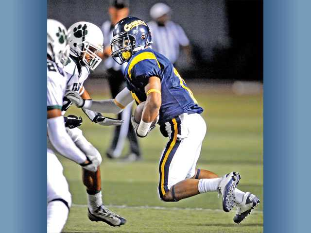 College of the Canyons wide receiver Keiotey Stenhouse looks for running room against East L.A. on Saturday at COC.