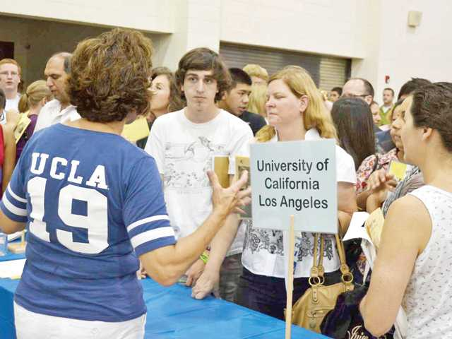 West Ranch High School senior Robert Gammariello and his mother, Anne, visit the UCLA table for admission requirements at the William S. Hart Union High School District's College & Career Fair on Sept. 7 at West Ranch High School. More than 4,000 parents and students attended the free event.
