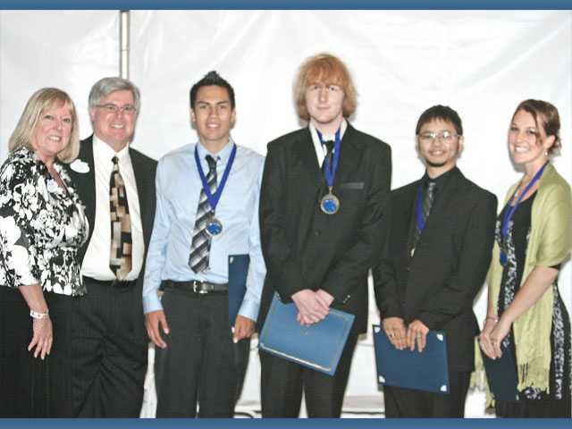 Left to right, Sue and Chris Hoefflin with scholarship winners Mark Jackson, Christian Dooley, Jonathan Alvarez and Carlene Hadden.