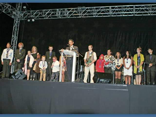 Children with cancer who have benefited from the services of the Michael Hoefflin Foundation are introduced by Ed Lin, interim executive director of the Hoefflin Foundation, center, during the 18th annual Evening Under the Stars, held at Mann Biomedical Park in Valencia.