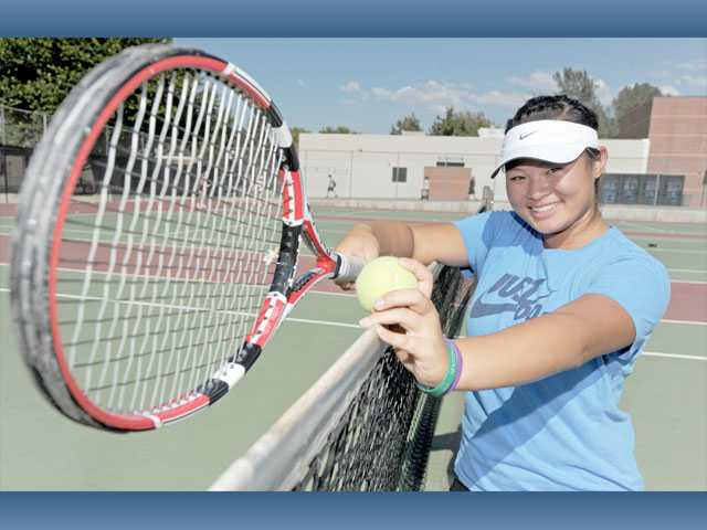 Hart High sophomore Lauren Dam is the seventh member of her family to play varsity tennis for the school, but the first one to play on the girls team.
