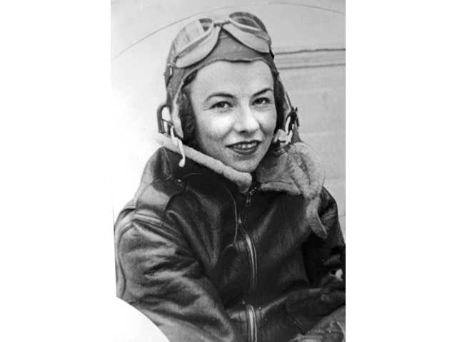 Neale poses in her flight gear in 1942. She flew several aircraft, including P-38s, P-51s, P-47s, P-63s, P-39s and B-25s.
