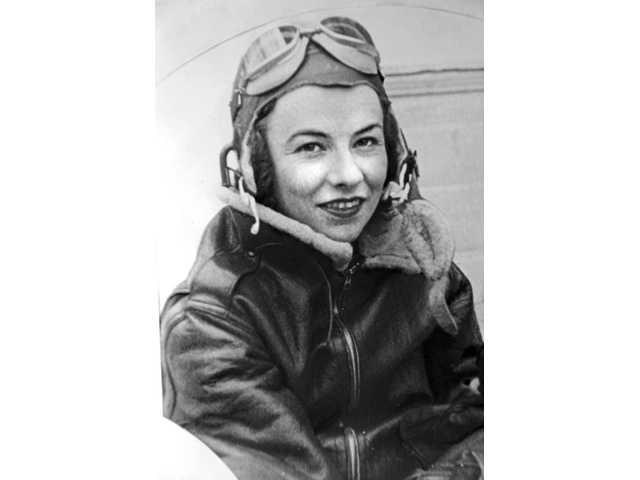 Neale poses in her flight gear in 1942. She flew several aircraft, including P-38s, P-51s, P-47s, P-63s, P-39s and B-25s.