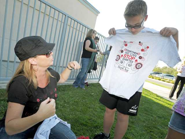 Lori Blumenthal, manager of the American Diabetes Association Santa Clarita Valley Step Out walk, with her son Cameron Ziegler, 12, who has Type 1 diabetes.