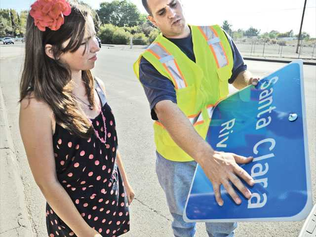 Doroginsky, right, explains how the sign was created to Senior Girl Scout Isabella Clark, 14. Clark spearheaded the campaign to post the signs as her Girl Scout project last month.