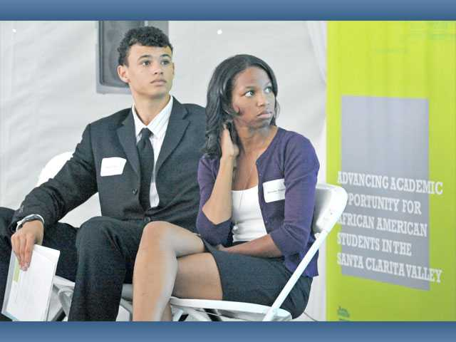 Kevin Ross, left, and Brooke Bogan listen to a presentation from Stephen Settles at Boston Scientific in Valencia on Friday.