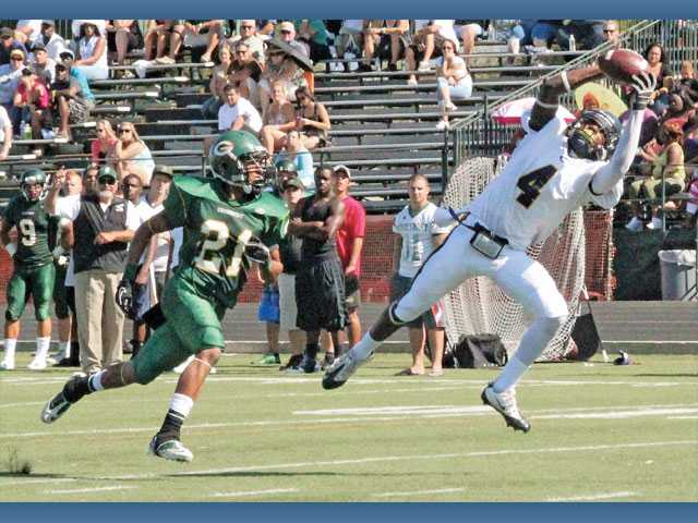 College of the Canyons wide receiver Travion Tucker reaches out to make the grab in front of Grossmont defensive back Eldredge Calhoun on Saturday at Grossmont College.