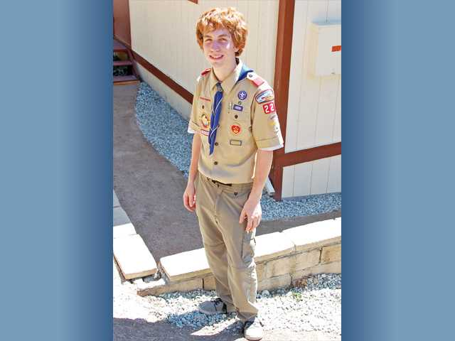 Saugus High School senior Thomas Callier stands by the Santa Clarita Valley Senior Center in Newhall. The member of Scout Troop 228 recently spent a year upgrading pathways around the center as part of his project for the Eagle Scout rank, a high Boy Scout honor.