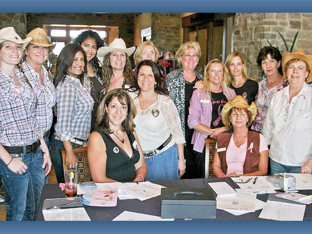 Soroptimist President Sandi Naba, center standing, with the board of directors and members at the 2011 Bras for a Cause Denim and Diamond Hoe-Down, on Sunday at the Tournament Players Club in Valencia.