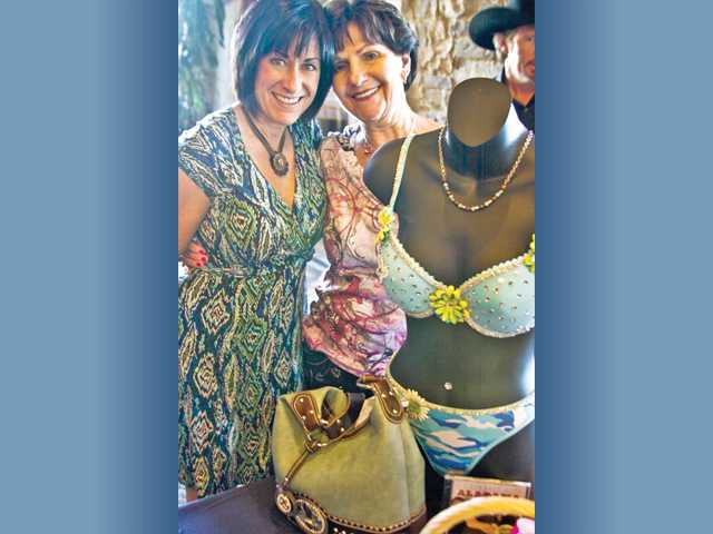 "From left, Dee Dee Jacobson of the Planning Commission of the Santa Clarita Valley, with Soroptimist Kaye Cruger, was the winning bidder for the ""Angels Among Us"" bra set donated by Tracey Ferguson."
