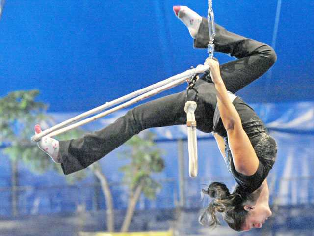 Yasmin Rivera rehearses a routine on an aerial hoop, or lyra, under the big top of Circus Vargas at Westfield Valencia Town Center on Thursday.