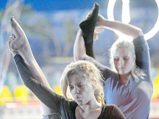 Driely Neves, left, and Hayley Kent practice contortion as Circus Vargas prepares for its first performance under the big top at Westfield Valencia Town Center