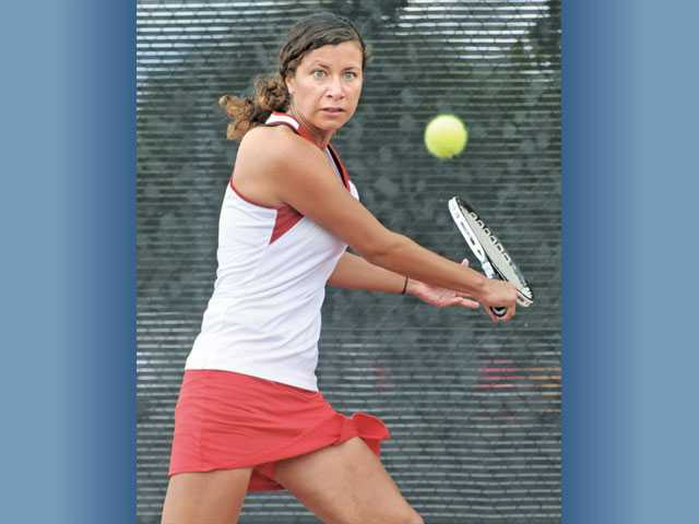 Hart singles player Jackie Resler returns a shot against West Ranch on Thursday at Hart High School.