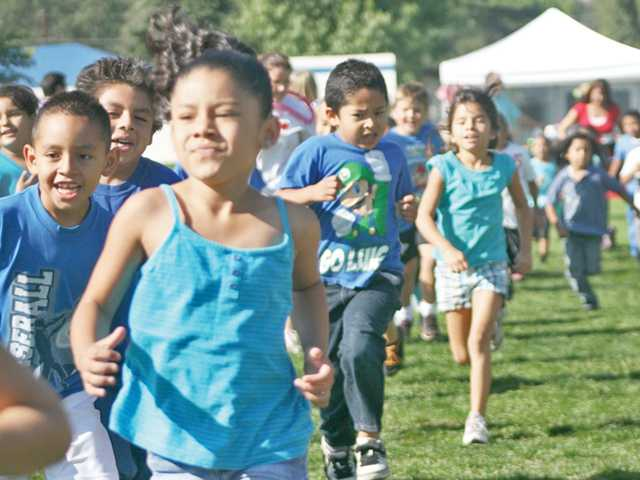 Students run in the inaugural Tri-A-Thon to raise money and improve student health at Newhall Elementary School on Sept. 23. The Parent-Teacher Association organized the event, which raised $10,000.
