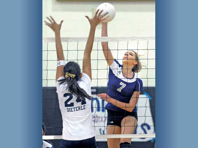 Valencia's Delaney Knudsen (4) and Kellie Kleszcz (15) of Valencia High block a shot by Amanda Dieterle (24) of West Ranch at West Ranch on Tuesday.